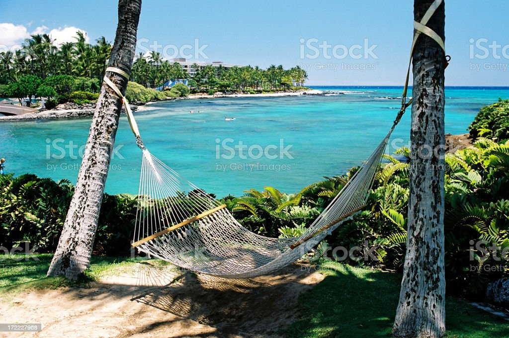 Hawaii resort hotel beach side Pacific ocean front hammock stock photo