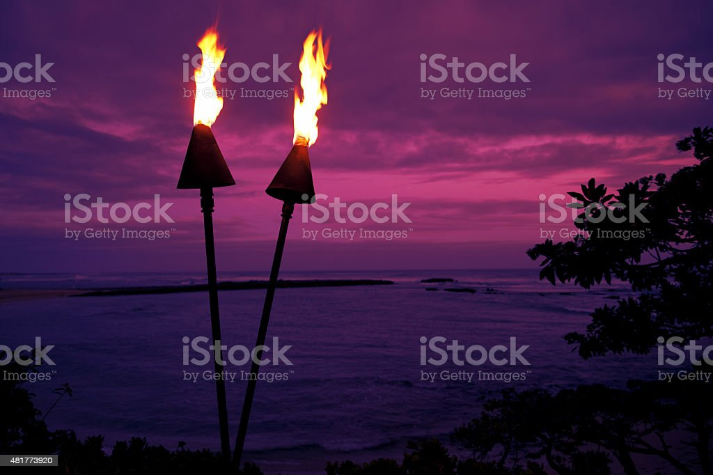 Hawaii Tiki Torches in at Sunset stock photo