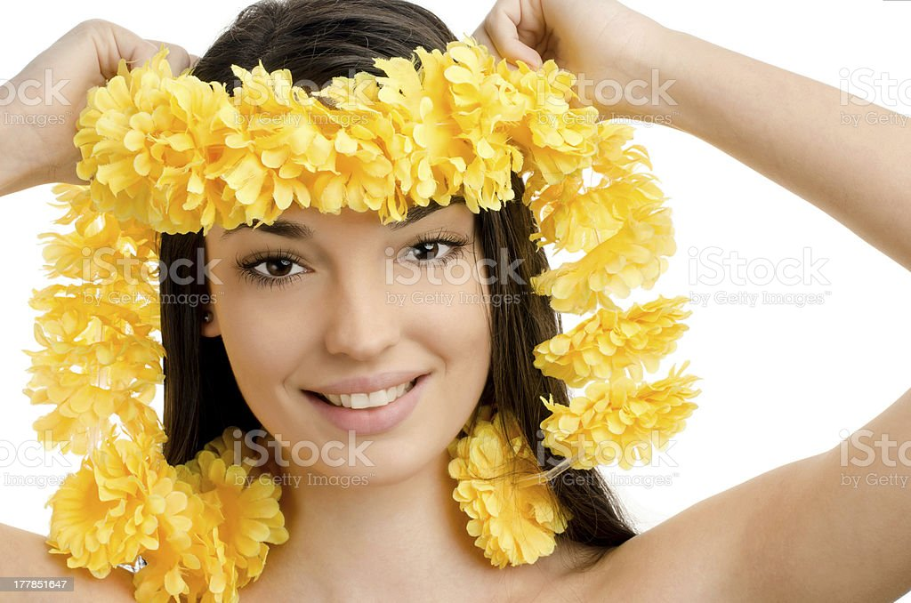 Hawaii woman showing a yellow flower lei garland. royalty-free stock photo