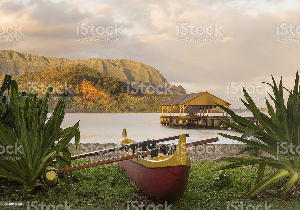 Hawaiian canoe by Hanalei Pier stock photo