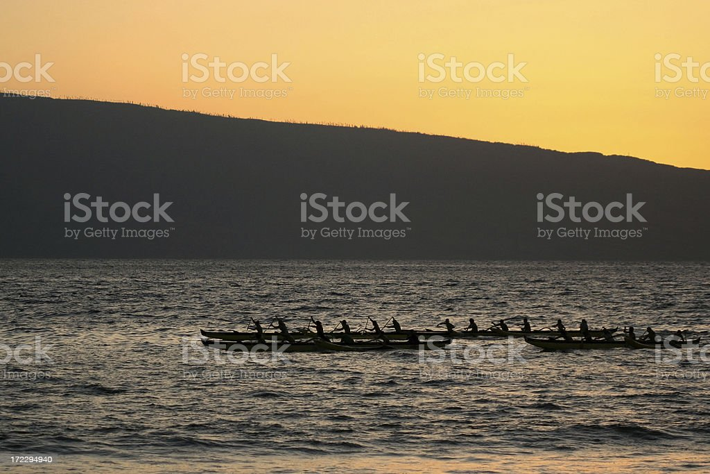 Hawaiian canoes at sunset. royalty-free stock photo