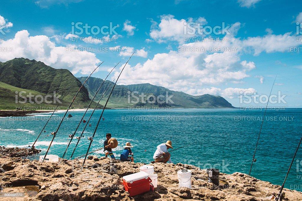Hawaiian Family Fishing at Ka'ena Point in Oahu stock photo