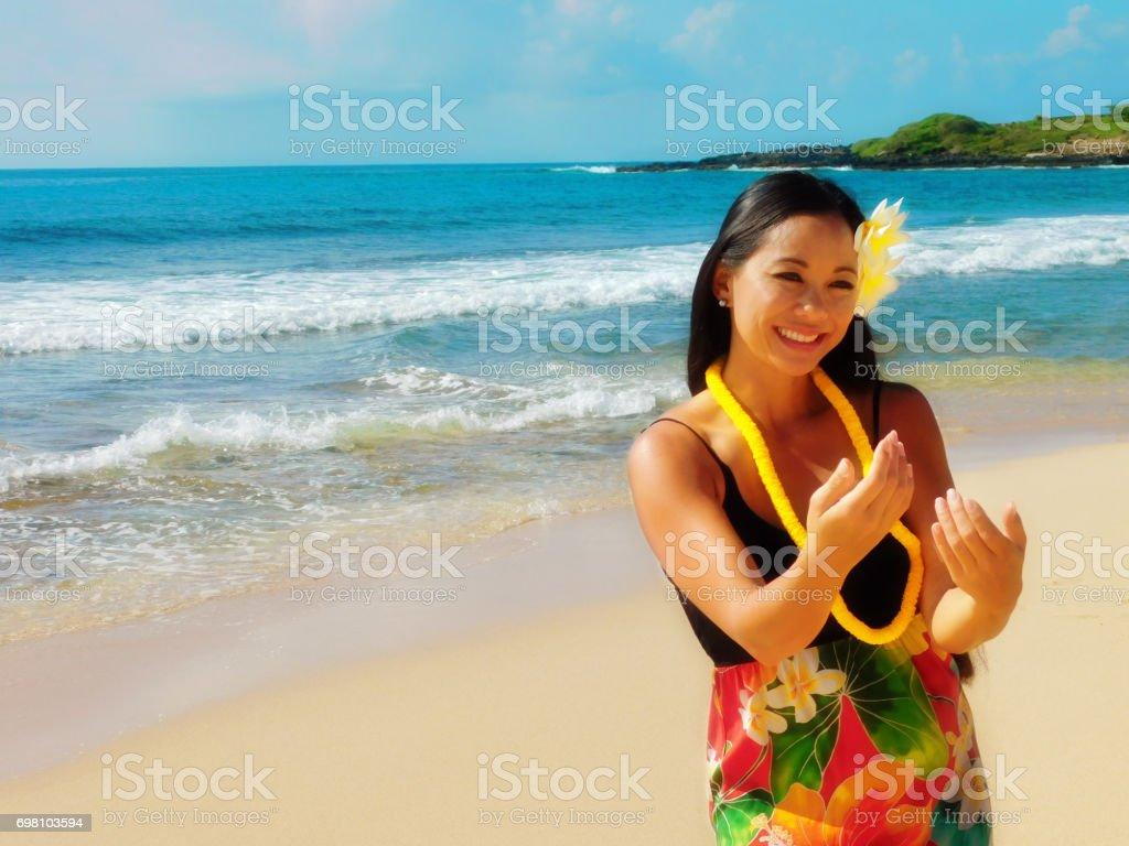 Hawaiian Hula Dancer Dancing on the Beach stock photo