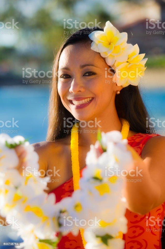 Hawaiian Hula Dancer Welcoming Visitor with Lei stock photo