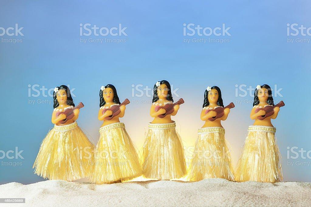Hawaiian Hula Dancers on Beach at Sunset stock photo