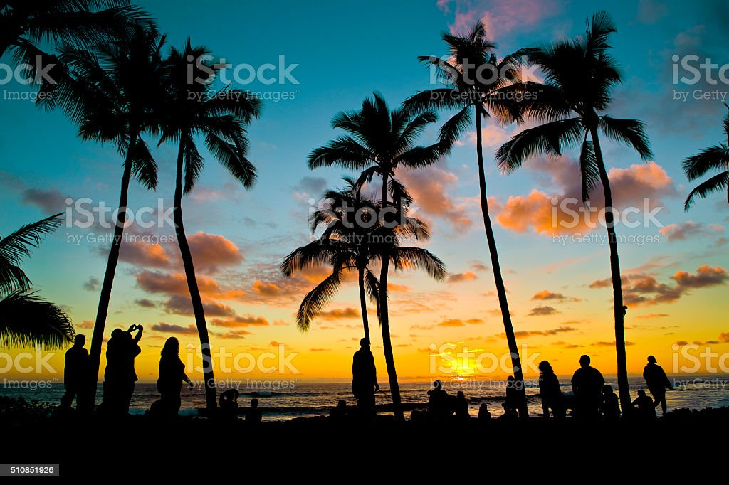 Hawaiian Island Sunset with Vacationing Tourist People, Kauai, Hawaii, USA stock photo