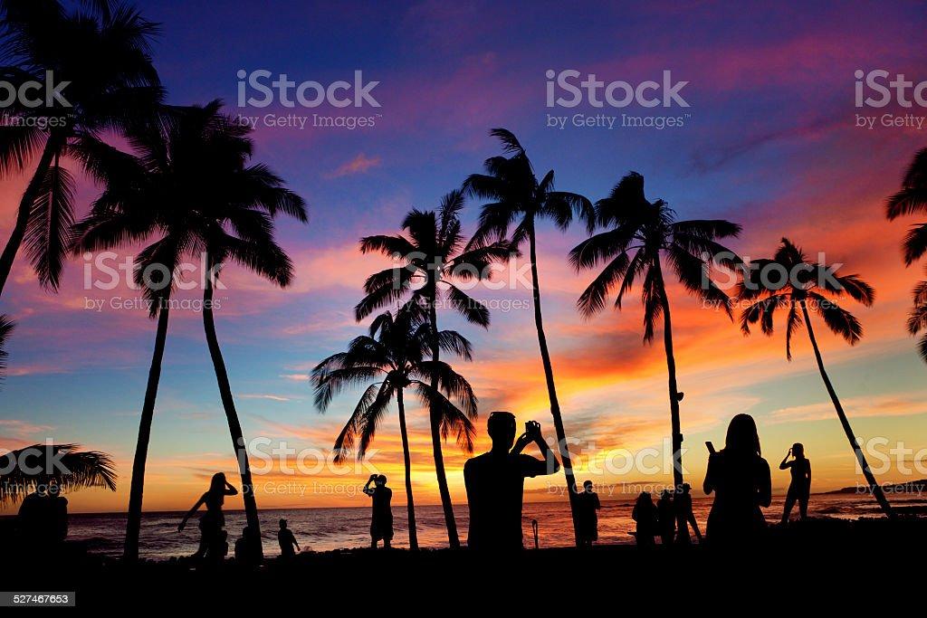 Hawaiian Island Sunset with Vacationing Tourist People, Kauai, Hawaii, USA stock photo