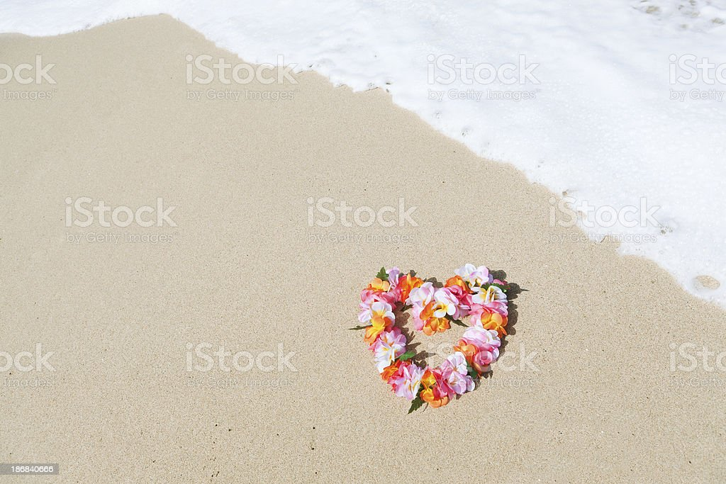 Hawaiian Lei on the Tropical Paradise Beach royalty-free stock photo