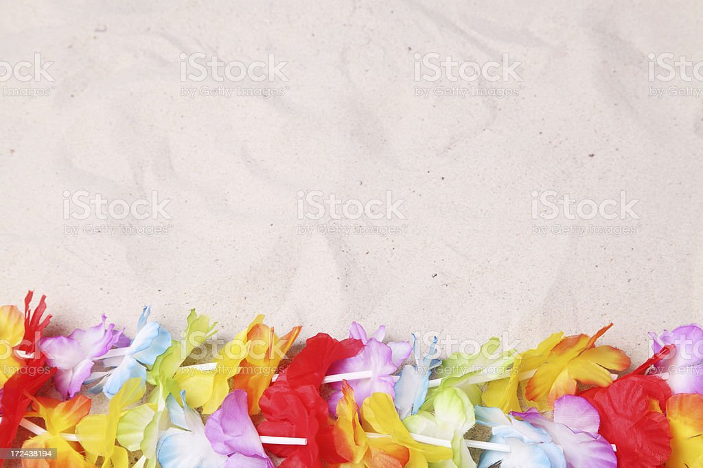 Hawaiian Lei on white sand royalty-free stock photo