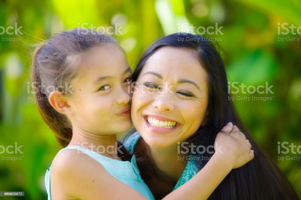 Hawaiian Polynesian Young Woman with Adolescent Daughter Children stock photo