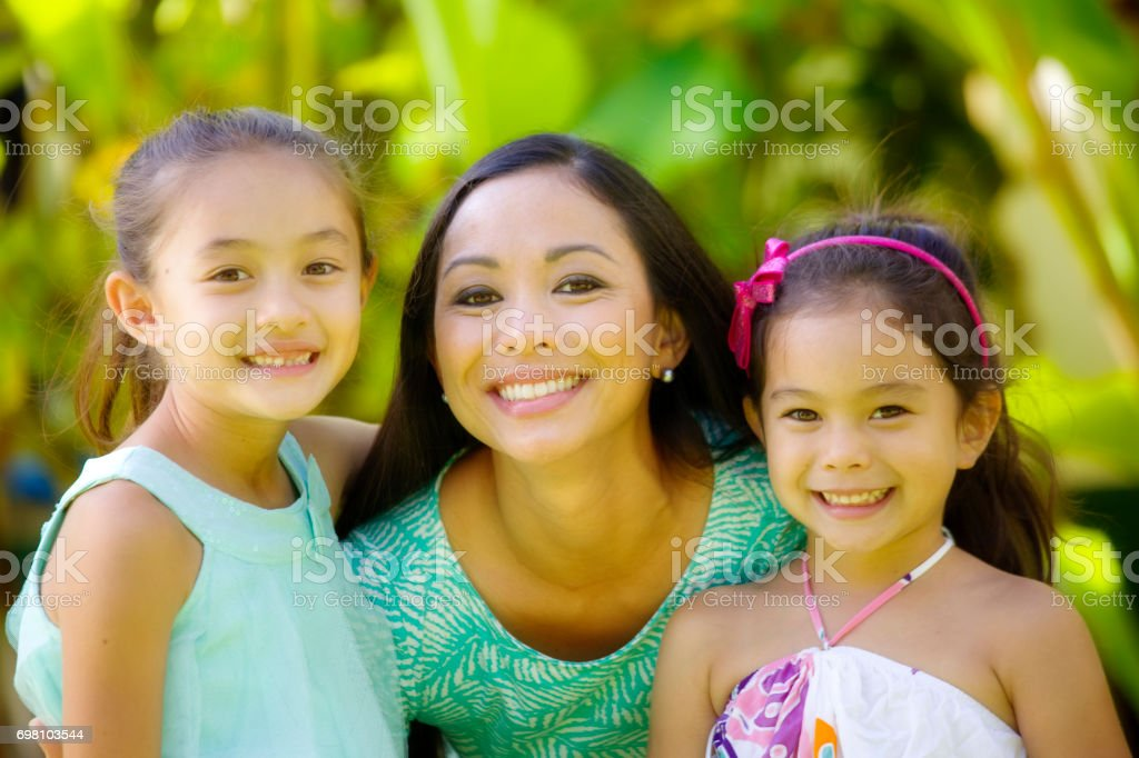 Hawaiian Polynesian Young Woman with Adolescent Daughters Children stock photo