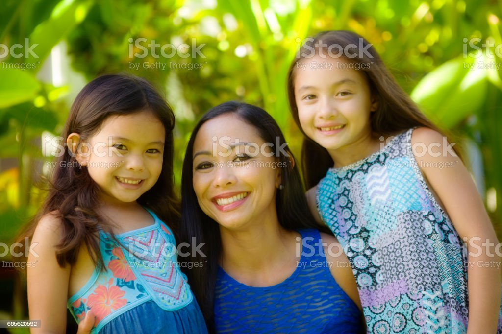 Hawaiian Polynesian Young Woman with Adolescent Two Daughters Children stock photo
