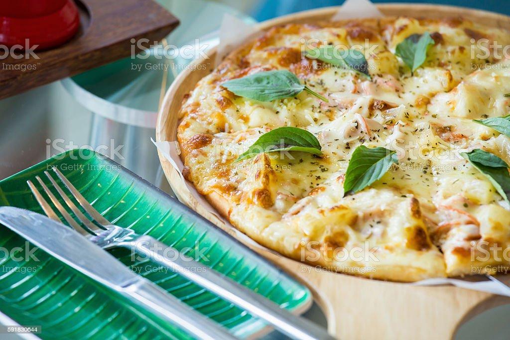 Hawaiian style pizza with pineapples stock photo