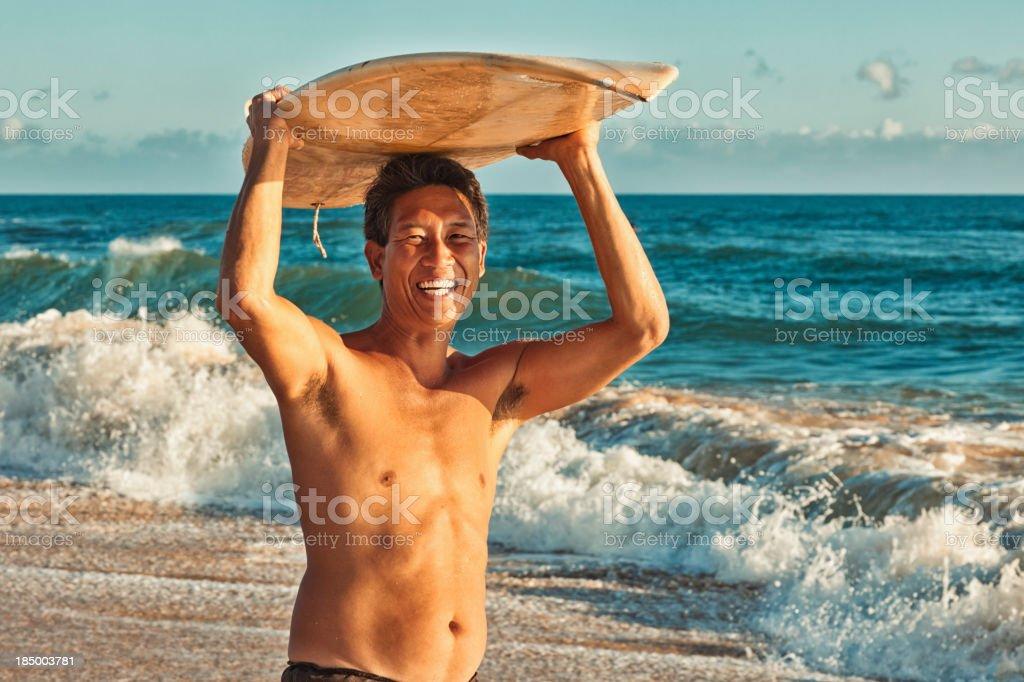 Hawaiian Surfer Standing on Beach with Surfboard royalty-free stock photo