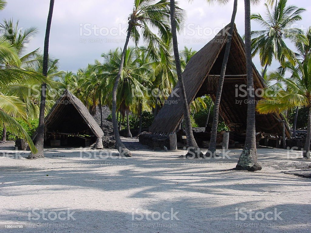 Hawaiian thatched huts, refuge royalty-free stock photo