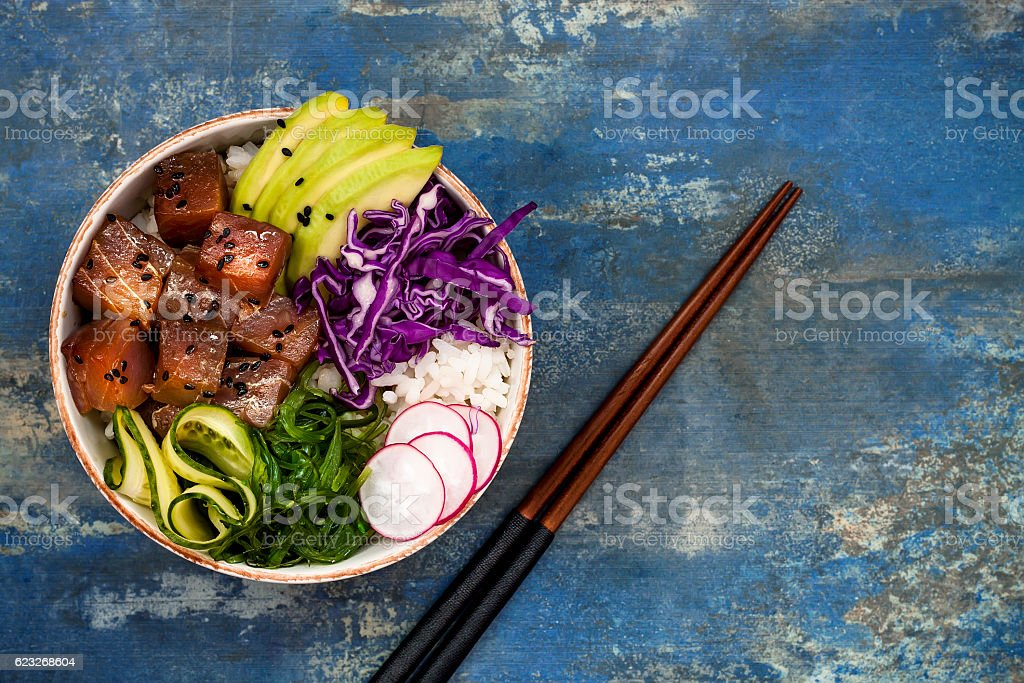 Hawaiian tuna poke bowl with seaweed, avocado, red cabbage slaw stock photo