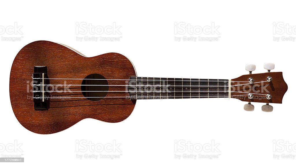 Hawaiian ukulele guitar with four strings isolated on white royalty-free stock photo