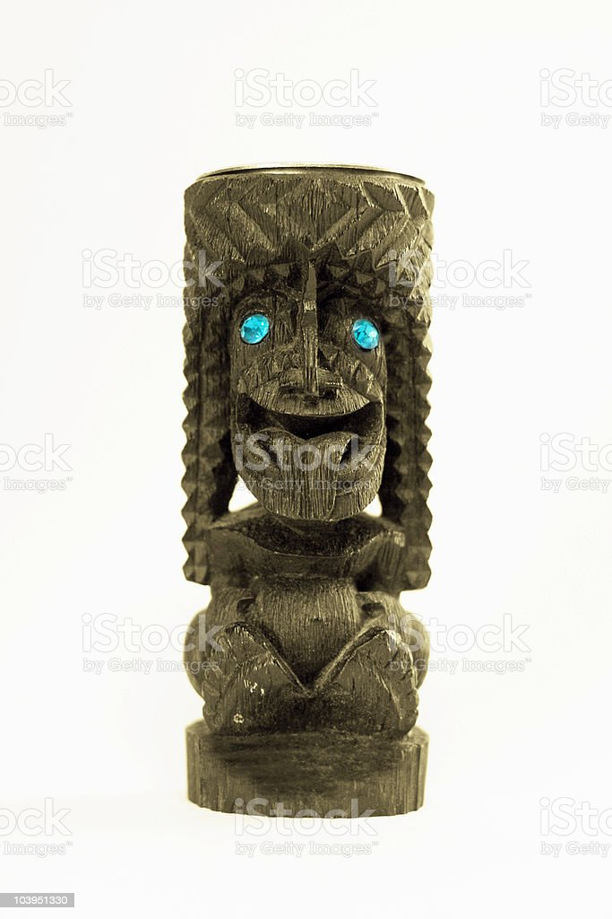 Hawaiian-Carved Tiki Statue on White Background stock photo