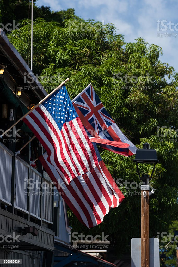 Hawaiin state flag with American flags stock photo