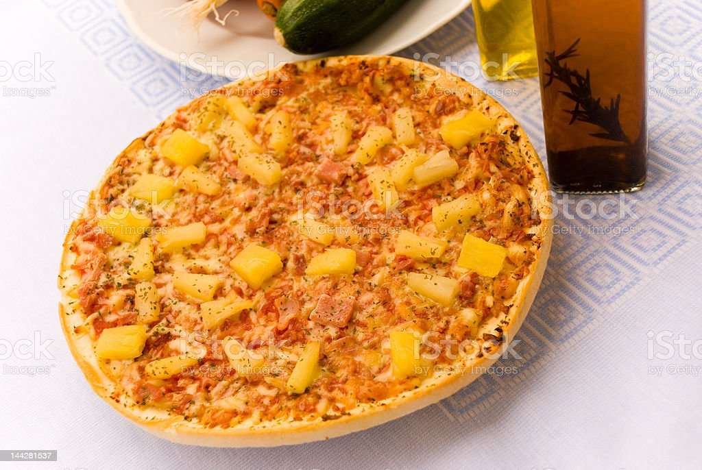 Hawaii-Pizza with ham,pineapple,etc. stock photo