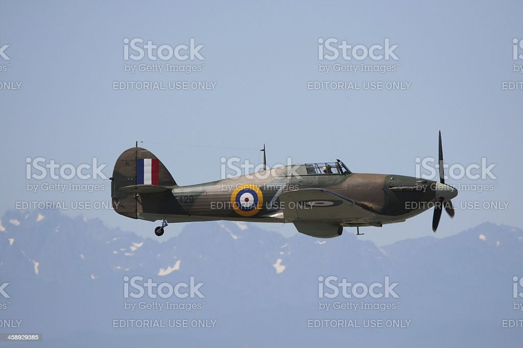 Hawker Hurricane XII Flying With Mountains Behind royalty-free stock photo
