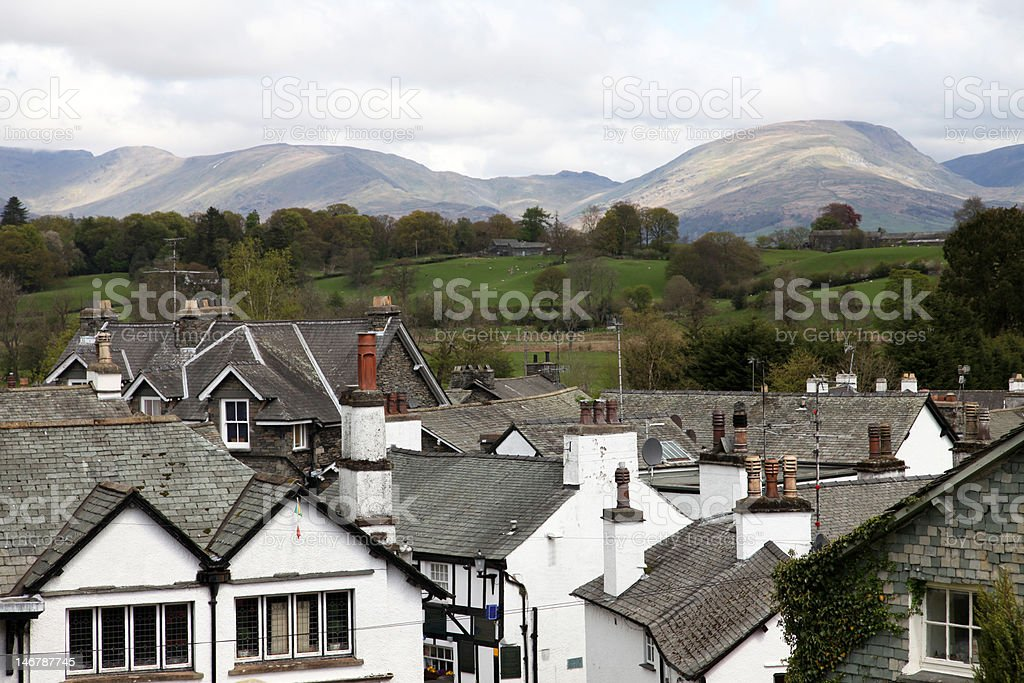 Hawkshead village with mountains in background stock photo