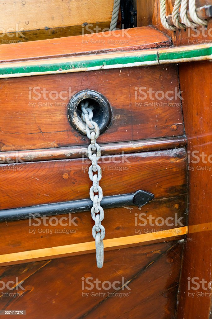 Hawsehole with anchor chain stock photo