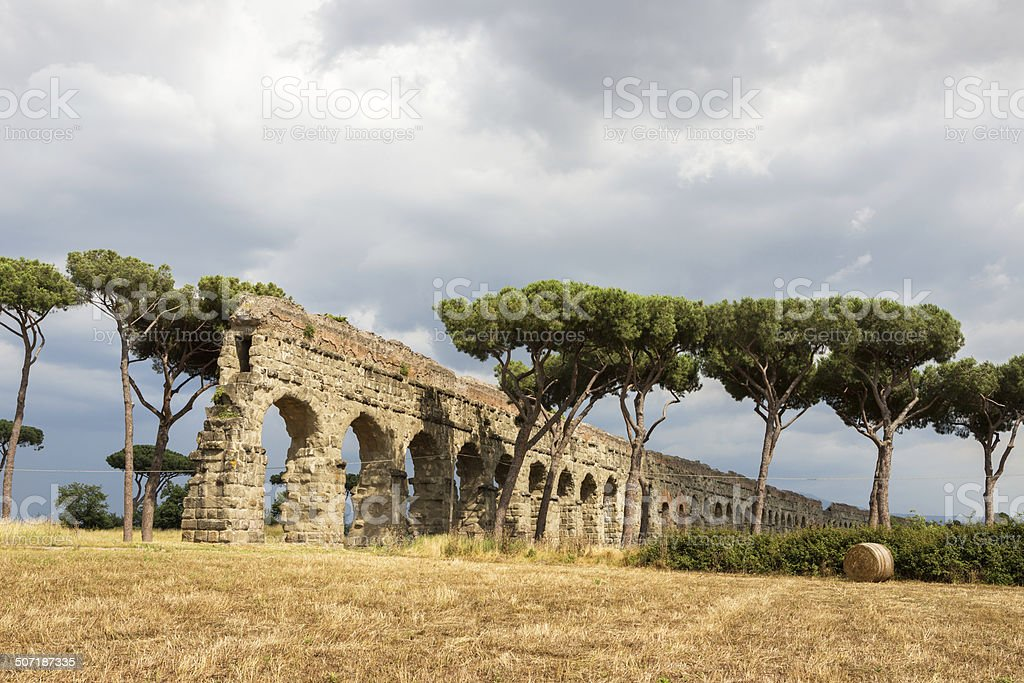 Hay bales and aqueduct, Rome Italy stock photo