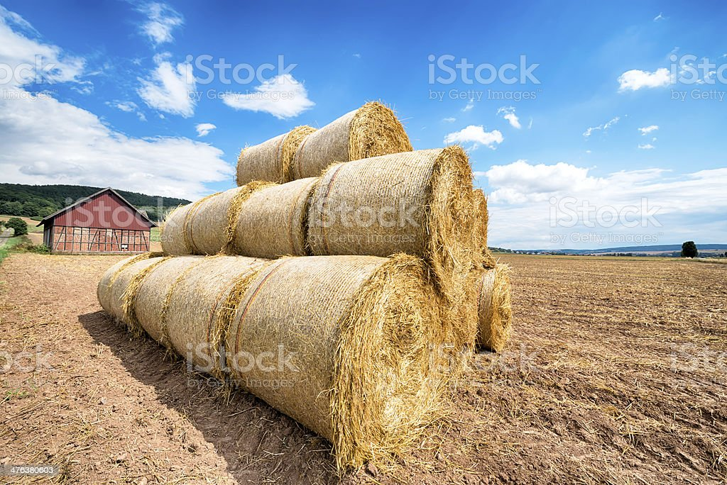 Hay bales in front of an old barn royalty-free stock photo