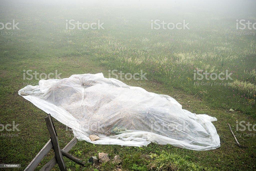 Hay bales in white nylon royalty-free stock photo
