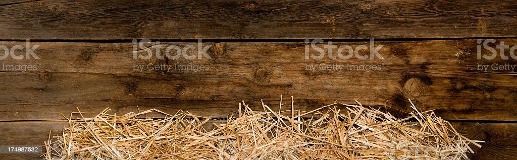 Hay edges on barnwood-panorama stock photo
