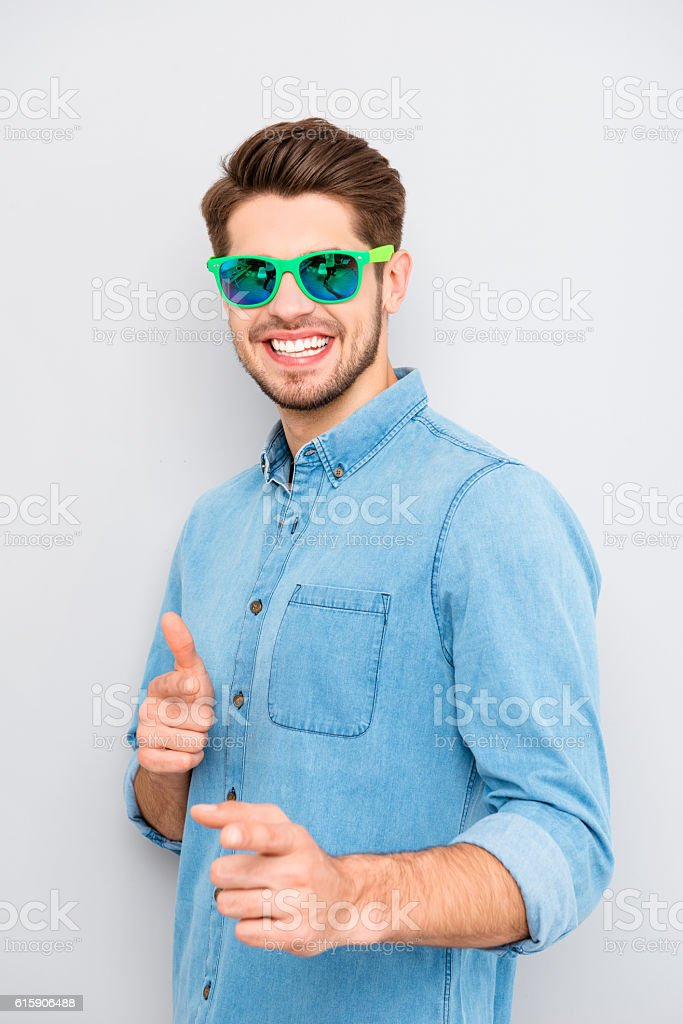 hay! funny stylish  young  man with glasses showing his fingers stock photo