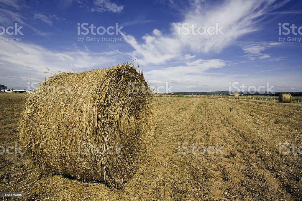 Hay roll and clouds royalty-free stock photo