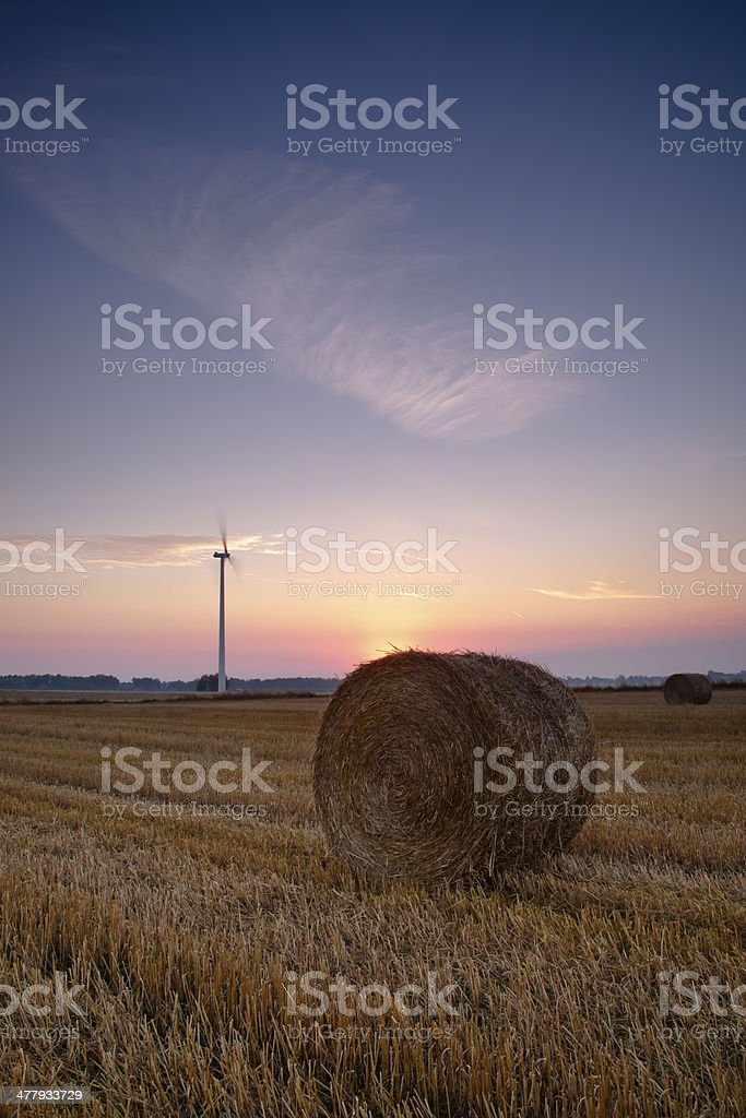 hay roll on fallow field royalty-free stock photo