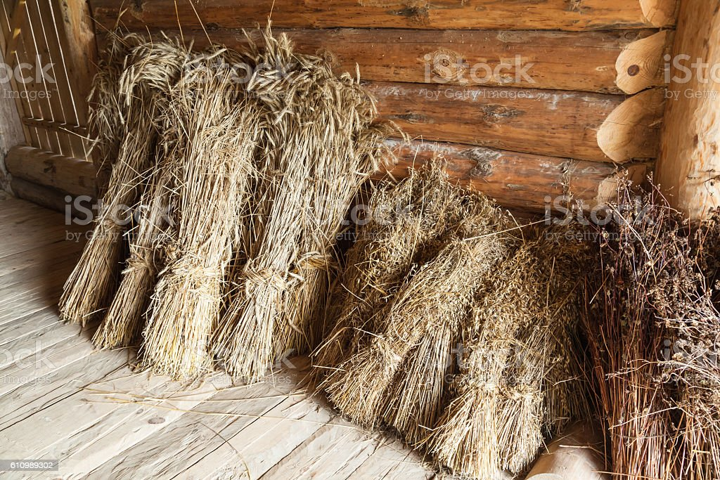 Hay sheaves in old wooden barn interior stock photo