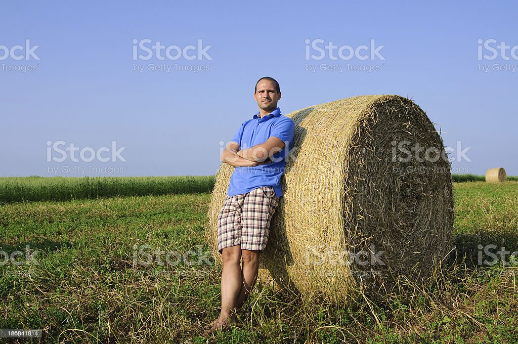 Haybale with person royalty-free stock photo