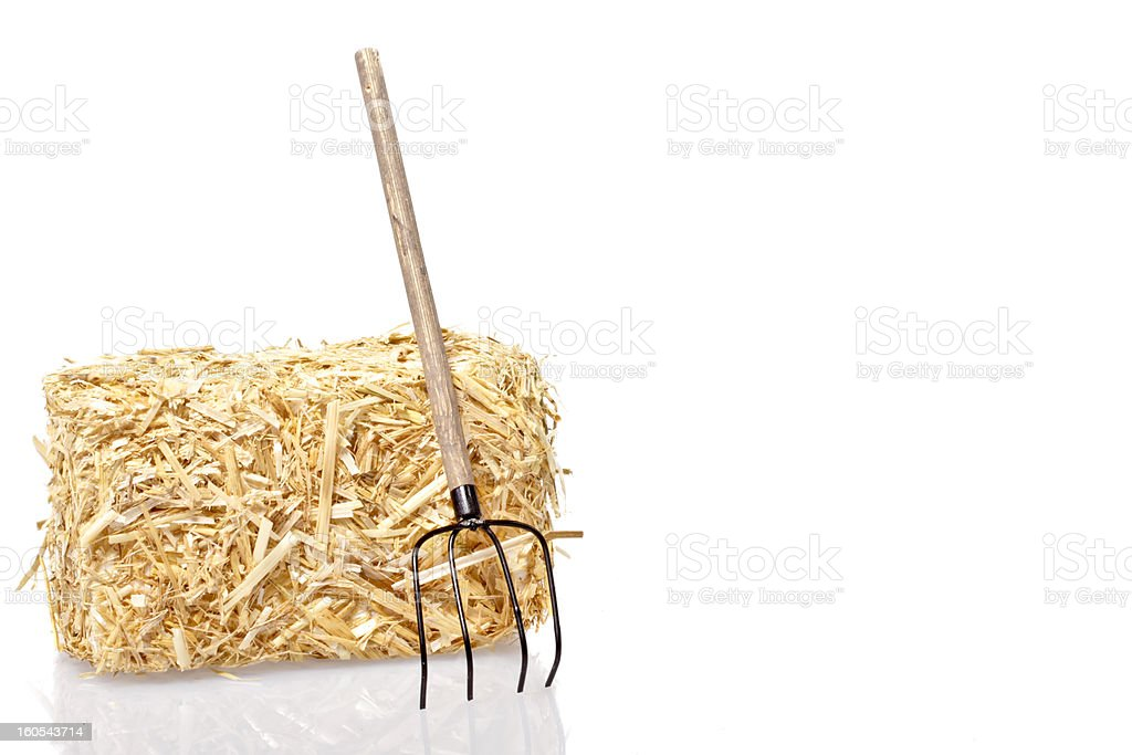Haybale with tool stock photo