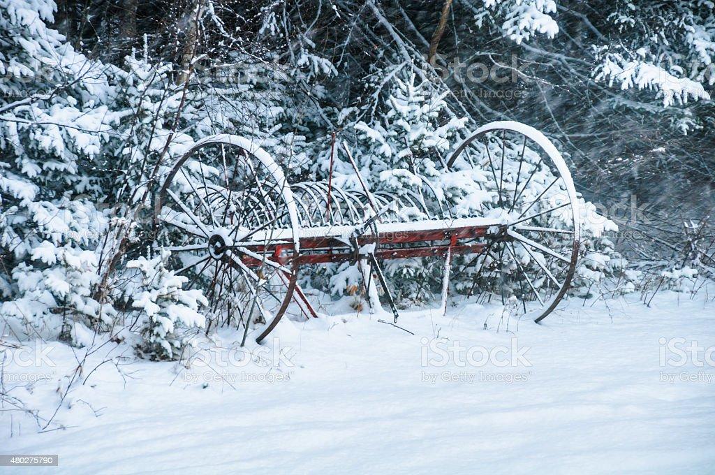 Hayrake in the Snow stock photo