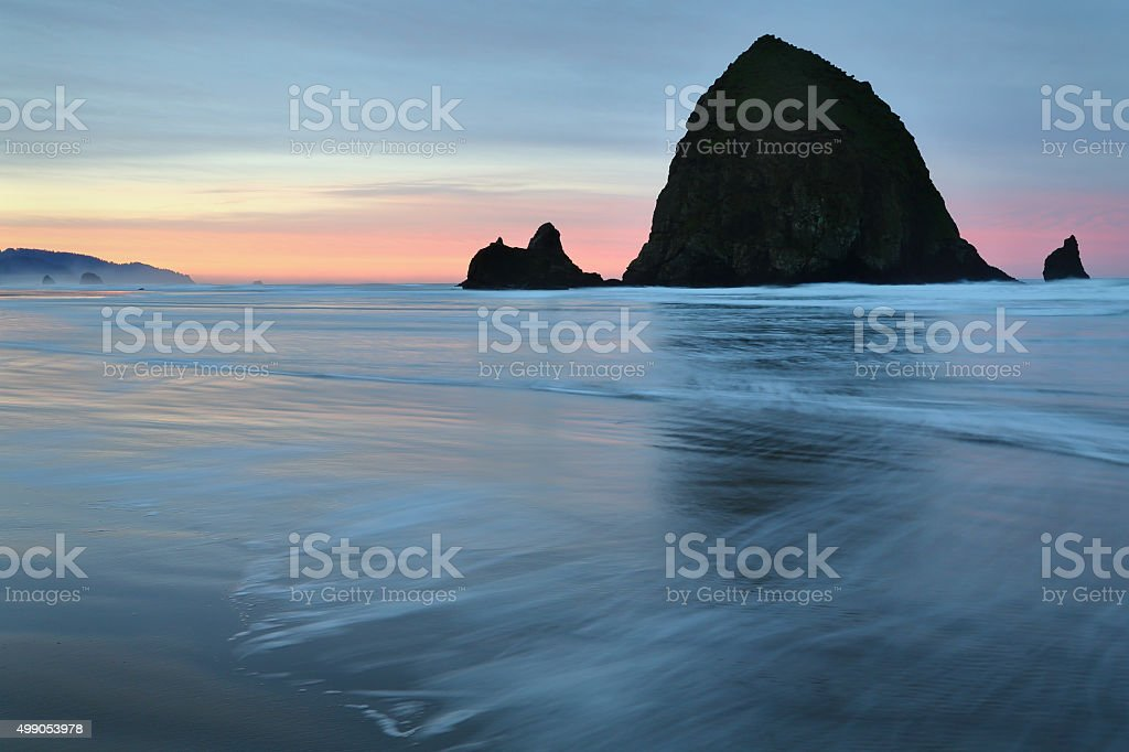 Haystack Rock, Cannon Beach, Oregon Sunrise stock photo