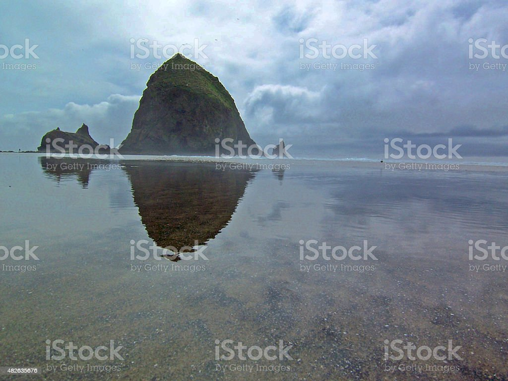 Haystack Rock with Storm Clouds stock photo