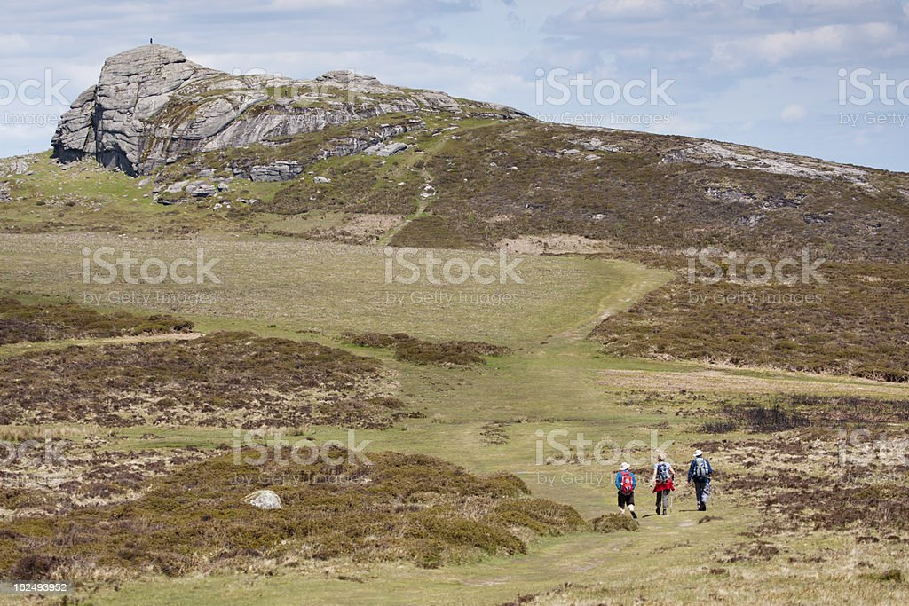 Haytor rocks and three walkers on Dartmoor, Devon stock photo