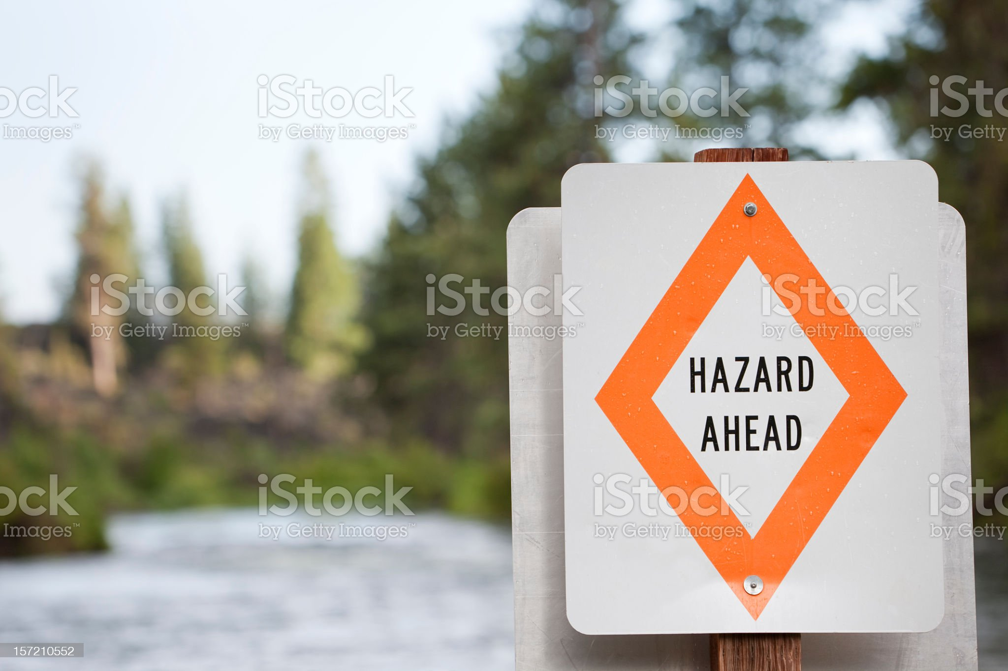 Hazard Ahead Warning Sign On River royalty-free stock photo