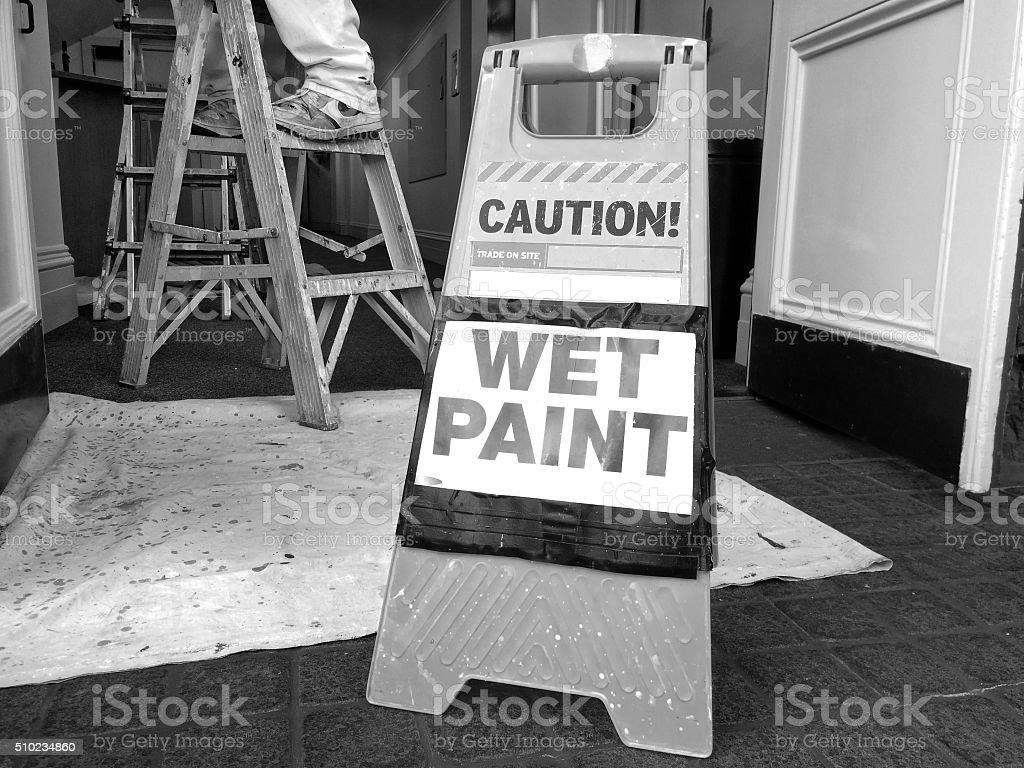 Hazard sign reads: Caution Wet Paint stock photo