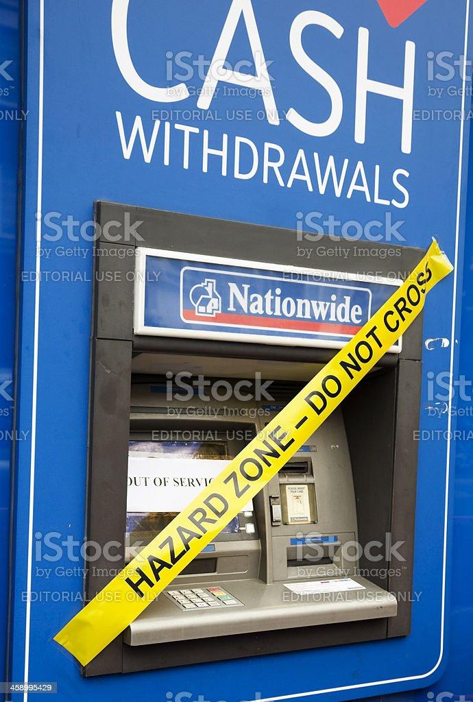 Hazard warning on cash machine stock photo