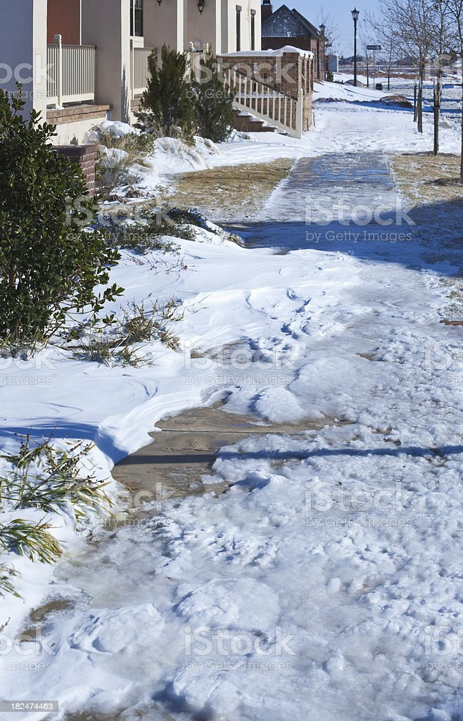 hazardous icy snowy winter suburban sidewalk royalty-free stock photo