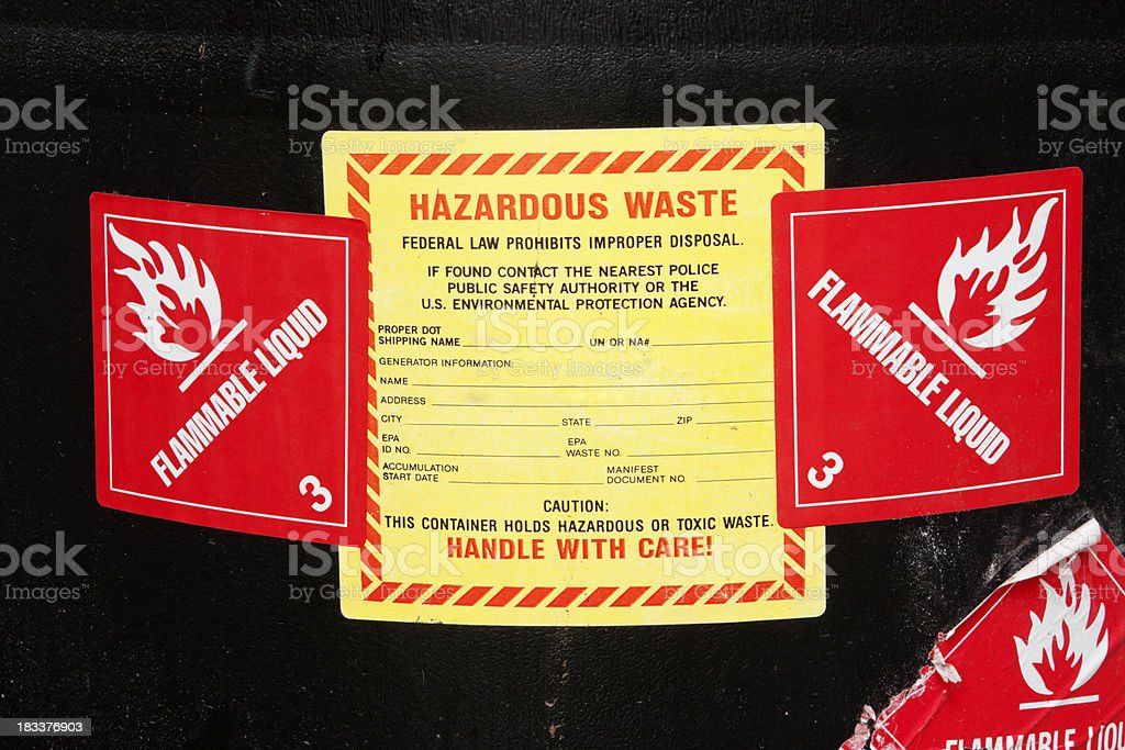 Hazardous Waste Lables on a Barrel of Chemicals stock photo