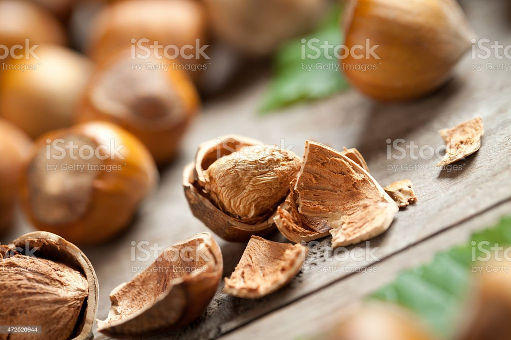 Hazelnuts close up on wooden table stock photo