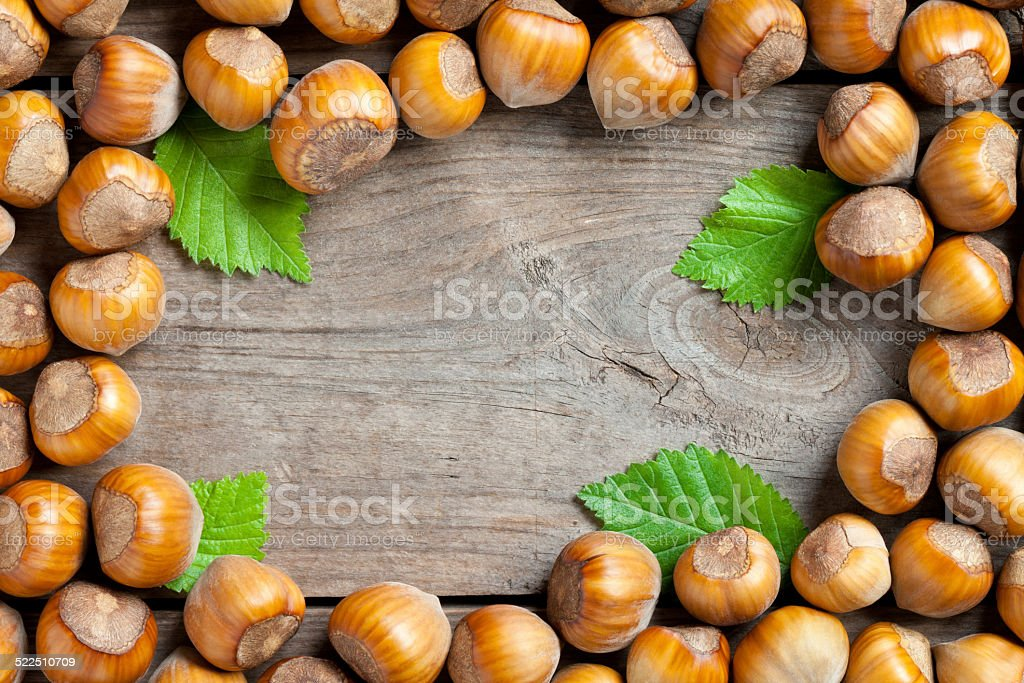 Hazelnuts frame on old table stock photo