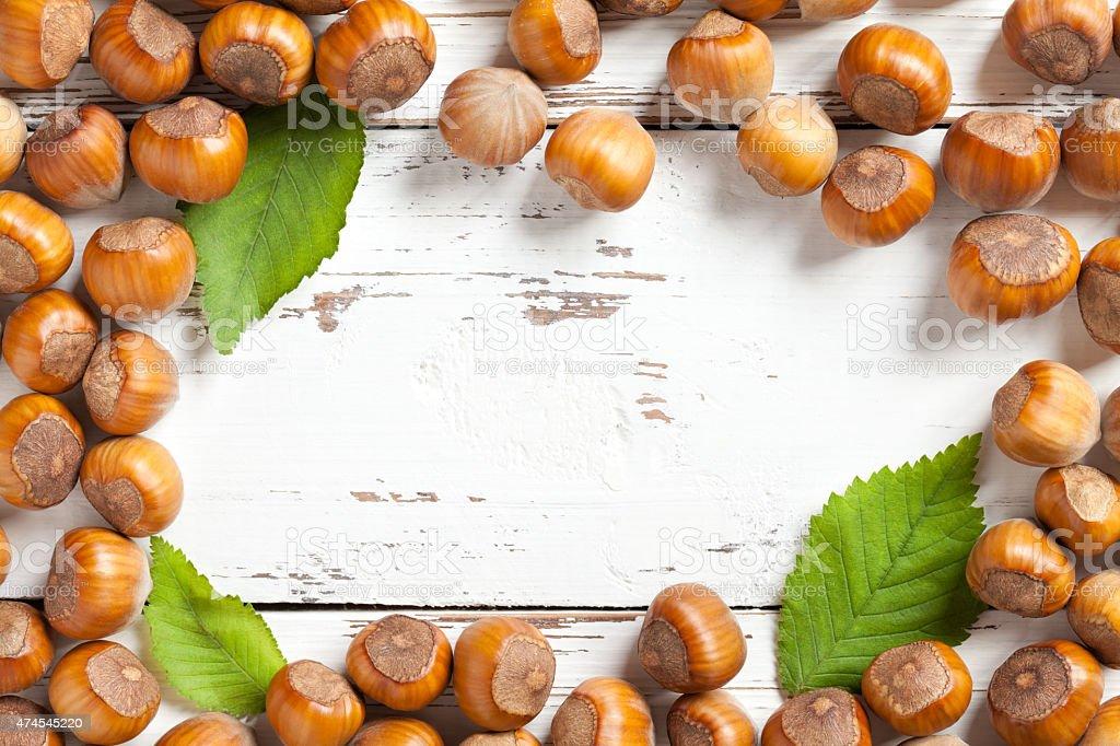 Hazelnuts frame on white table stock photo