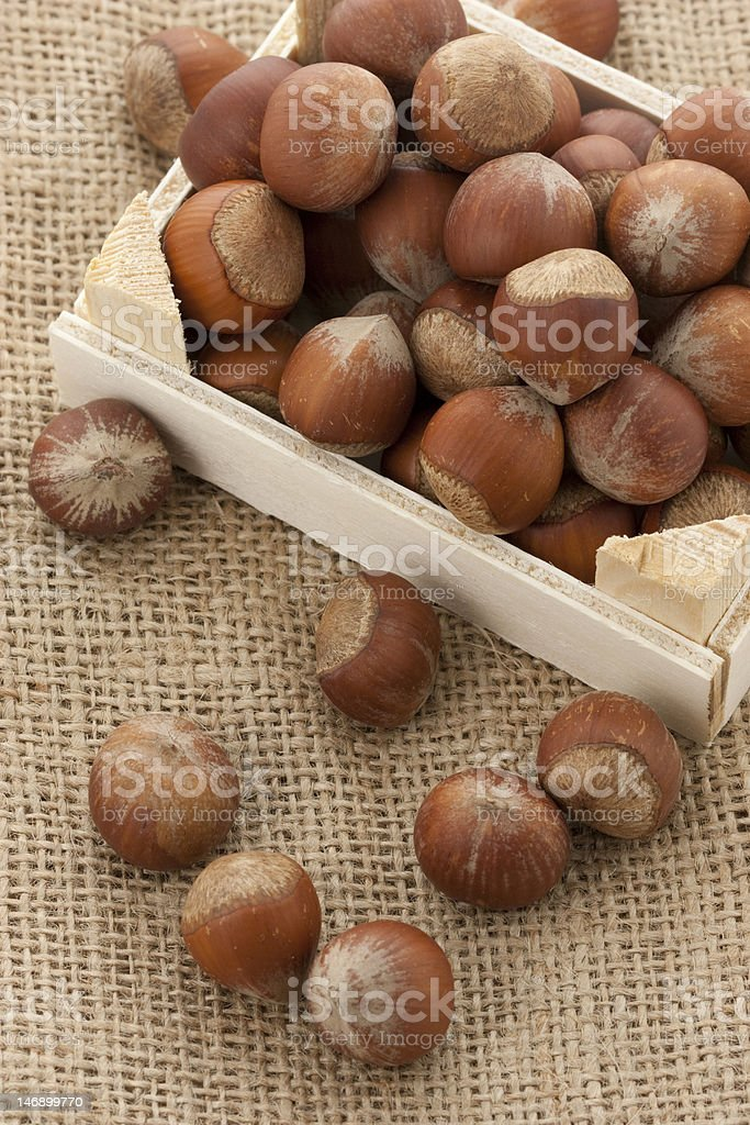hazelnuts in little crate royalty-free stock photo